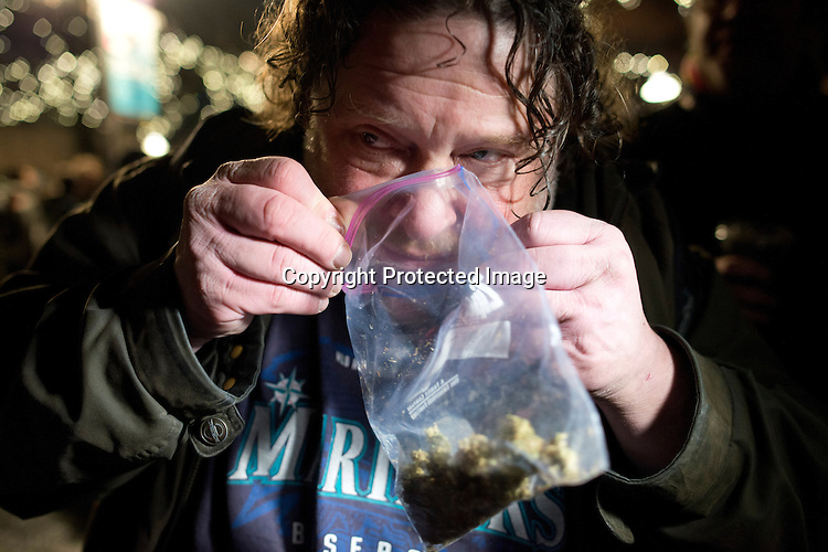 Just after midnight, Washington legalized possession of up to an ounce of marijuana for recreational use for those over 21 under Initiative 502, which took effect Thursday, Dec. 6. 2012. A public celebration hailed as Legalization Day in Washington State attracted about a hundred people to Seattle Center's International Fountain Thursday evening, after a similar event at 12:01 a.m. near the Space Needle. Public smoking is still against the law, and marijuana remains counter to federal law. Colorado passed a similar measure. Photo by Daniel Berman/www.bermanphotos.com