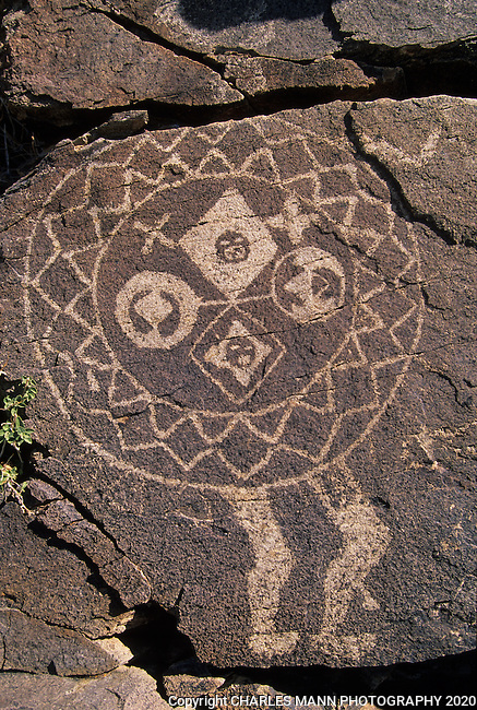 """A petroglyph of a headless """"shield man"""" represents a mysterious link to the Anasazi people who left it behind in the Galesteo River Basin near the village of Galesteo, New Mexico"""