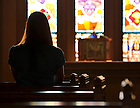 Praying in the Law School Chapel..Photo by Matt Cashore/University of Notre Dame