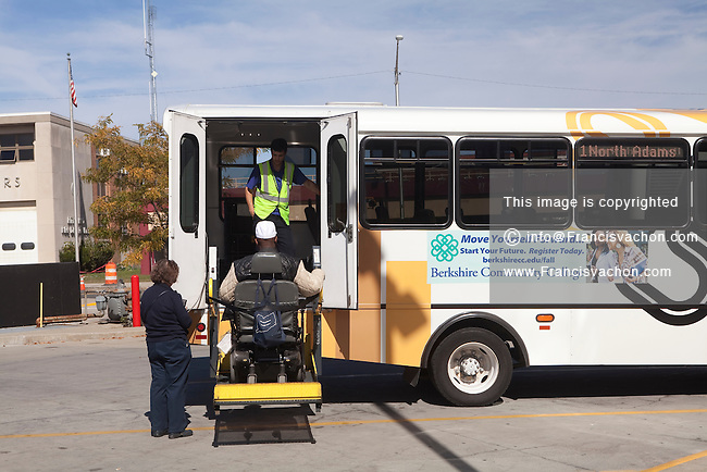 A men in a wheelchair is lifted into a BRTA bus at the intermodal center station in Pittsfield, Massachusetts Thursday October 3, 2013. Berkshire Regional Transit Authority serves the Berkshire County in Western Massachusetts.