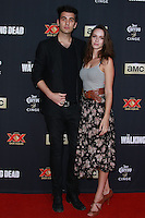 UNIVERSAL CITY, CA, USA - OCTOBER 02: Nick Simmons, Alex Essoe arrive at the Los Angeles Premiere Of AMC's 'The Walking Dead' Season 5 held at AMC Universal City Walk on October 2, 2014 in Universal City, California, United States. (Photo by David Acosta/Celebrity Monitor)