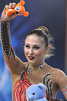 Daria Kondakova of Russia waves little mouse after routine during Event Finals at 2011 Holon Grand Prix, Israel on March 5, 2011.  (Photo by Tom Theobald).