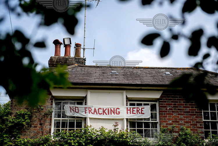 An anti fracking banner hangs on the outside of a house in Balcombe, West Sussex. Hydraulic Fracturing (fracking)  company Cuadrilla Resources Ltd has been granted an exploration licence for a site just outside the rural village sparking a campaign, supported by the majority of residents, against the proposed exploration. /Felix Features