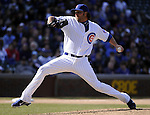 CHICAGO - APRIL  05:  James Russell #40 of the Chicago Cubs pitches against the Arizona Diamondbacks on April 5, 2011 at Wrigley Field in Chicago, Illinois.  The Cubs defeated the Diamondbacks 6-5.  (Photo by Ron Vesely) Subject: James Russell