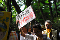 Tokyo, Japan - June 17: A woman held a sign, which said &quot;Don't Restart,&quot; against nuclear power plants in Japan during a demonstration at Mitaka, Tokyo, Japan on June 17, 2012. As Japanese Government decided to restart Oi Nuclear Power Plants No.3 and 4 in Fukui, people spoke up against the restart throughout the nation. .