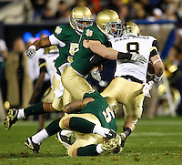 Army's quarterback Trent Steelman (8), is tackled by Notre Dame's Harrison Smith(22) and Manti Te'o(5) in the 2nd. quarter of the Notre Dame vs. Army football game at Yankee Stadiumm on Saturday, November 20, 2010. Photo by Errol Anderson.