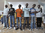 Haitian-Dominican youth pray in the front row of an evangelical church in La Hoya, a small rural town near Barahona in the southwest of the Dominican Republic. This service brings together Dominicans and Haitian-Dominicans from a nearby batey in an unusual demonstration of unity in a land where discrimination against Dominicans of Haitian ancestry is growing.