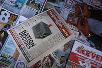 An election special newspaper on sale at a newsstand ahead of Burma's first multi-party elections since 1990. However, the main pro-democracy party, the NLD (National League for Democracy), boycotted the poll and other opposition groups have alleged widespread voting fraud.