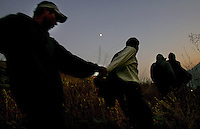 A group of illegal immigrants, walks along a path in the Otay Mesa Mountain Range, just east of San Diego.  The immigrants were caught by an elite Border Patrol unit that combs remote parts of the border that are unaccessable to vehicles.