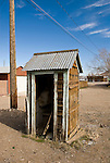 Wooden outhouse with open door in the town of Goldfield, Nev.