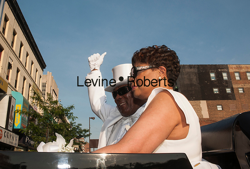 """Isaiah Owens, the owner of Owens Funeral Home, in Harlem in New York, with his wife Lillie Owens, arrives on Friday, June 21, 2013, at the Apollo Theater for a showing of Christine Turner's documentary film """"Homegoings"""".  The film features Owens and his funeral home as it studies African-American traditions of death. Owens, who moved to New York in the 1960's, opened the funeral home and with just word of mouth and little advertising has become the paramount funeral home in Harlem, due to his care and understanding.  (© Richard B. Levine)"""