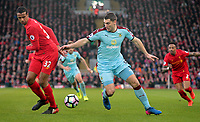 Liverpool's Joel Matip vies for possession with Burnley's Sam Vokes<br /> <br /> Photographer Rich Linley/CameraSport<br /> <br /> The Premier League - Liverpool v Burnley - Sunday 12 March 2017 - Anfield - Liverpool<br /> <br /> World Copyright &copy; 2017 CameraSport. All rights reserved. 43 Linden Ave. Countesthorpe. Leicester. England. LE8 5PG - Tel: +44 (0) 116 277 4147 - admin@camerasport.com - www.camerasport.com