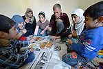 Souad Kasem Issa and her husband Ziad Hasan Noaman, along with five of their six children, share a meal in the apartment where they live in Amman, Jordan. The family of eight fled the city of Homs, Syria, as fighting there worsened in 2012. Their home in Syria has since been destroyed by bombing, and they are struggling to survive in Jordan's capital city. They are receiving some assistance from International Orthodox Christian Charities, is a member of the ACT Alliance.