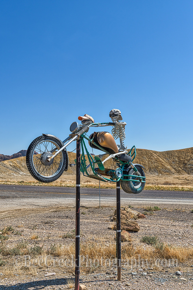 Another capture in a verticle of the skeleton bike rider with the extra head but at least they were protecting their eye with some cool sun glasses this was just down the road in Butte.