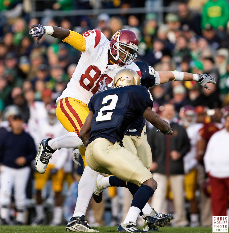 10/17/09 - South Bend, IN:  USC tight end Anthony McCoy gets tackled by Notre Dame cornerback Darrin Walls during their game at Notre Dame Stadium on Saturday.  USC won the game 34-27 to extend its win streak over Notre Dame to 8 games.  Photo by Christopher McGuire.
