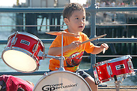 Adam de la Pena, 4, plays the drums at the Santa Monica Pier on Tuesday, July 12, 2011.