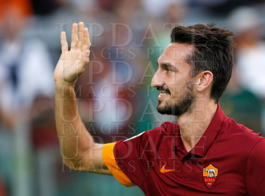 Calcio, amichevole Roma vs Fenerbahce. Roma, stadio Olimpico, 19 agosto 2014.<br /> AS Roma defender Davide Astori greets fans during the team's presentation, prior to the friendly match between AS Roma and Fenerbache at Rome's Olympic stadium, 19 August 2014.<br /> UPDATE IMAGES PRESS/Riccardo De Luca