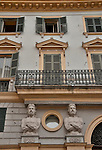 Architectural detail of a building in Turin, Italy with figures of men over the doorway
