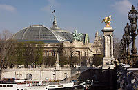File of streetlights, Pont Alexandre III, 1896-1900 for World Expo 1900 to commemorate the French-Russian Alliance of 1892, by the architects J. Cassine-Bernard and G. Cousin and engineers A. Alby and J. Resal, Grand Palais in the distance, 1897-1900 for World Expo 1900, by the architects Henri-Adolphe-Auguste Deglane, Louis-Albert Louvet, Albert-Félix-Théophile Thomas and Charles-Louis Girault, 8th arrondissement, Paris, France Picture by Manuel Cohen