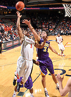 Jan. 2, 2011; Charlottesville, VA, USA; Virginia Cavaliers guard Jontel Evans (1) shoots the ball in front of LSU Tigers forward Garrett Green (3) during the game at the John Paul Jones Arena. Virginia won 64-50. Mandatory Credit: Andrew Shurtleff-