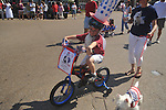 Nicholas Diaz rides a bike in the 4th of July parade in Oxford, Miss. on Monday, July 4, 2011.