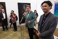 "Vienna, Austria. Galerie Suppan Contemporary. Vernissage of Zico Albaiquni (r., Indonesia), ""beyond the veil"". Martin Suppan speaking."