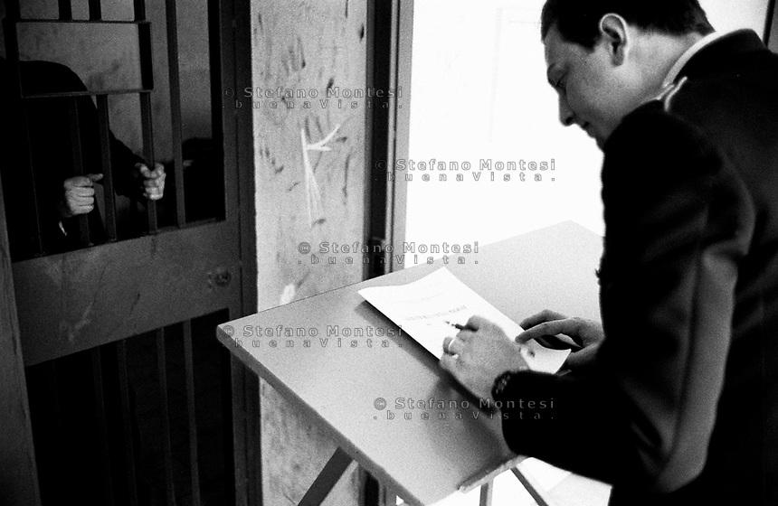 Roma 2000.Carcere di Regina Coeli  . Regina Coeli (Queen of Heaven) Prison..Office Matriculates, Police officer Penetentiary  registered a new prisoner