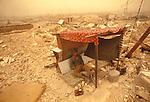 Marsh Arabs. Southern Iraq.  Marsh Arab soldier on guard after destruction of Marsh Arab village during then  Iran-Iraq War.