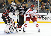 Chris Rawlings (NU - 37), Dax Lauwers (NU - 44), Wade Megan (BU - 18) - The Northeastern University Huskies defeated the Boston University Terriers 3-2 in the opening round of the 2013 Beanpot tournament on Monday, February 4, 2013, at TD Garden in Boston, Massachusetts.