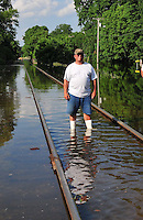 """8/13/11} Vicksburg} -- Vicksburg, MS, U.S.A. --Members of the Kings Community in Vicksburg Mississippi spend Friday The 13, 2011 checking out the rising Mississippi flood water into their homes. Robert Shiers aka Peanut paddles past his hand built cabin in the woods too check on the flood waters Friday May 13,2011 Peanuts flooded cabin on Chickasaw Road was a cabin in the woods is now a cabin on the flooded Mississippi River.  Hope and faith float as the Mississippi River continues to rise around the Kings Community on Friday the 13th of May 2011. """"Peanut """" aka Robert Shiers navigates his """"John Boat"""" down Chickasaw Rd. in Vicksburg Mississippi. His hand built ,self designed cabin which sits on 14ft. stilts on the old Belle Meade Plantation was on a 5acre wheat field that is now inundated with water and only able to get to by boat.  No mail today for residents of the Kings Community in Vicksburg MS Friday May 13, 2011.The Mississippi River in Vicksburg, Mississippi is expected to crest at a record 58.5 feet. The water is moving at 2.2million cubic feet per second, to put it in perspective it would fill the SuperDome in New Orleans in 30 seconds. Pictured is the historic Yazoo Valley Railroad Station in downtown Vicksburg. The River is flooding over 1.2 million acres of farm land and damaging thousands of homes and disrupting thousands of peoples lives. Vicksburg a riverfront town steeped in war and sacrifice, gets set to battle an age-old companion: the Mississippi River. The city that fell to Ulysses S. Grant and the Union Army after a painful siege in 1863 is marshaling a modern flood-control arsenal to keep the swollen Mississippi from overwhelming its defenses. PHOTO©SUZI ALTMAN.COM.Photo by Suzi Altman."""