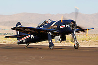 The Grumman built XF8F-1 Bearcat, owned and piloted by Howard Pardue, taxies along the ramp at Stead Field in Nevada following the 2007 Reno Air Races. BuNo 88458 is one of the first two prototypes ordered by the U.S. Navy in 1943. The Bearcat entered the Navy's air squadrons to late to see action in World War II and was quickly replaced by jets as a front line fighter in the years immediately following the war.  Photographed 09/07