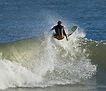 Folly Beach SC surfer rides the waves