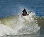 Folly Beach SC surfer rides the waves