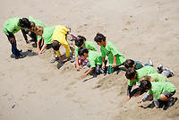 First grade students from Franklin Elementary dig for sand crabs during a field trip the Heal the Bay's Pier Aquarium on Monday, June 13, 2011