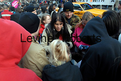 Kristie Salvo (C) of the On Fire Christian Center of Louisville KY leads congregation members in prayer after the rally. Evangelical teens rally in Times Square on February 8, 2008 as part of Battle Cry highlighting their concerns about the toll pop culture is taking on teenagers. The rally was part of Teen Mania which according to the organizers has more than 400,000 members. (© Richard B. Levine)