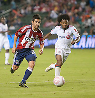 CARSON, CA – OCTOBER 9: Chivas USA midfielder Paolo Nagamura (26) and Toronto FC midfielder Julian De Guzman (6) during a soccer match at Home Depot Center, October 9, 2010 in Carson California. Final score Chivas USA 3, Toronto FC 0...