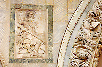Detailed carvings of Saint George on the facade of Saint Marks Basilica Venice