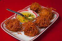 """Encamotao"" ( fried shrimp and chicken balls wrapped in sweet potato strings) at Madam Tusan restaurant in Lima, Peru."
