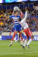 New York Red Bulls goalkeeper Bouna Coundoul (18) grabs a ball intended for Zach Loyd (19) of FC Dallas. The New York Red Bulls defeated FC Dallas 2-1 during a Major League Soccer (MLS) match at Red Bull Arena in Harrison, NJ, on April 17, 2010.