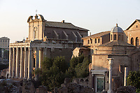 Temple of Antoninus and Faustina, 141 AD, transformed in the Christian era into the church of San Lorenzo In Miranda remaining the façade with the colossal columns in Euboeian marble, Temple of Divus Romulus (4th century AD) on the right, Roman Forum, Rome, Italy, Europe.