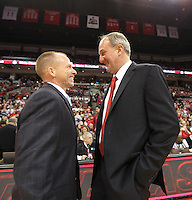 Ohio State head coach Thad Matta and North Florida head coach Matthew Driscoll share a moment before the start of the game, Friday, Nov. 29, 2013, in Columbus, Ohio. (Photo by Terry Gilliam)