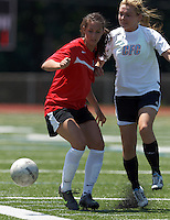 Aztec MA defender Carson Laderoute (24) attempts to control the ball as CFC Passion defender Shannon Larkin (9) pressures. In a Women's Premier Soccer League (WPSL) match, Aztec MA defeated CFC Passion, 4-0, at North Reading High School Stadium on July 1, 2012.