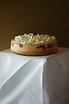 Simple image of grooms cake, cheesecake on a white table cloth.