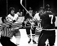 Seals vs Pittsburg Penguins , Seals Bob Stewart ready to rumble with Penguins Steve Durbano. Ron Huston. (1975 photo/Ron Riesterer)