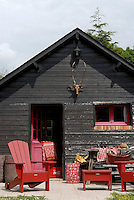 Guest rooms are situated in this wooden cabin at the bottom of the garden