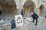 Father Emanuel Youkhana ponders the rubble in a Syriac Catholic Church in Qaraqosh, Iraq, on January 27, 2017. The Islamic State group, which occupied the town in 2014, set up a firing range for target practice in the courtyard of the church. Although the city was liberated in October, 2016, Christians are unlikely to return soon due to concerns about their security. Youkhana is a priest in Duhok of the Holy Apostolic Catholic Assyrian Church of the East.