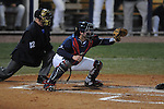 Ole Miss' Taylor Hightower (13) and home plate umpire Tony Walsh at Oxford-University Stadium in Oxford, Miss. on Wednesday, March 9, 2010.