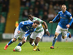 Celtic v St Johnstone.....04.03.15<br /> Danny Swanson gets around Mubarak Wakaso<br /> Picture by Graeme Hart.<br /> Copyright Perthshire Picture Agency<br /> Tel: 01738 623350  Mobile: 07990 594431