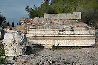 CORINTH, GREECE - APRIL 16 : A detail of Roman remains, on 16 April 2007 in Corinth, Greece. A fragment of an inscription mentioning Caesar and a Corinthian capital, lit by the early morning light, lie amongst the ruins of Corinth.  Founded in Neolithic times,  Corinth was a major Ancient Greek city, until it was razed by the Romans in 146 BC. Rebuilt a century later it was destroyed by an earthquake in Byzantine times. (Photo by Manuel Cohen)
