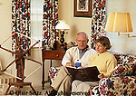 Active Aging Senior Citizens, Retired, Activities, Elderly Happily Retired at Home, Relaxed in Home, Couple Reading Together